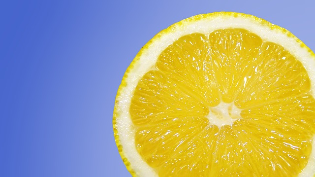 Slice of lemon on a blue background